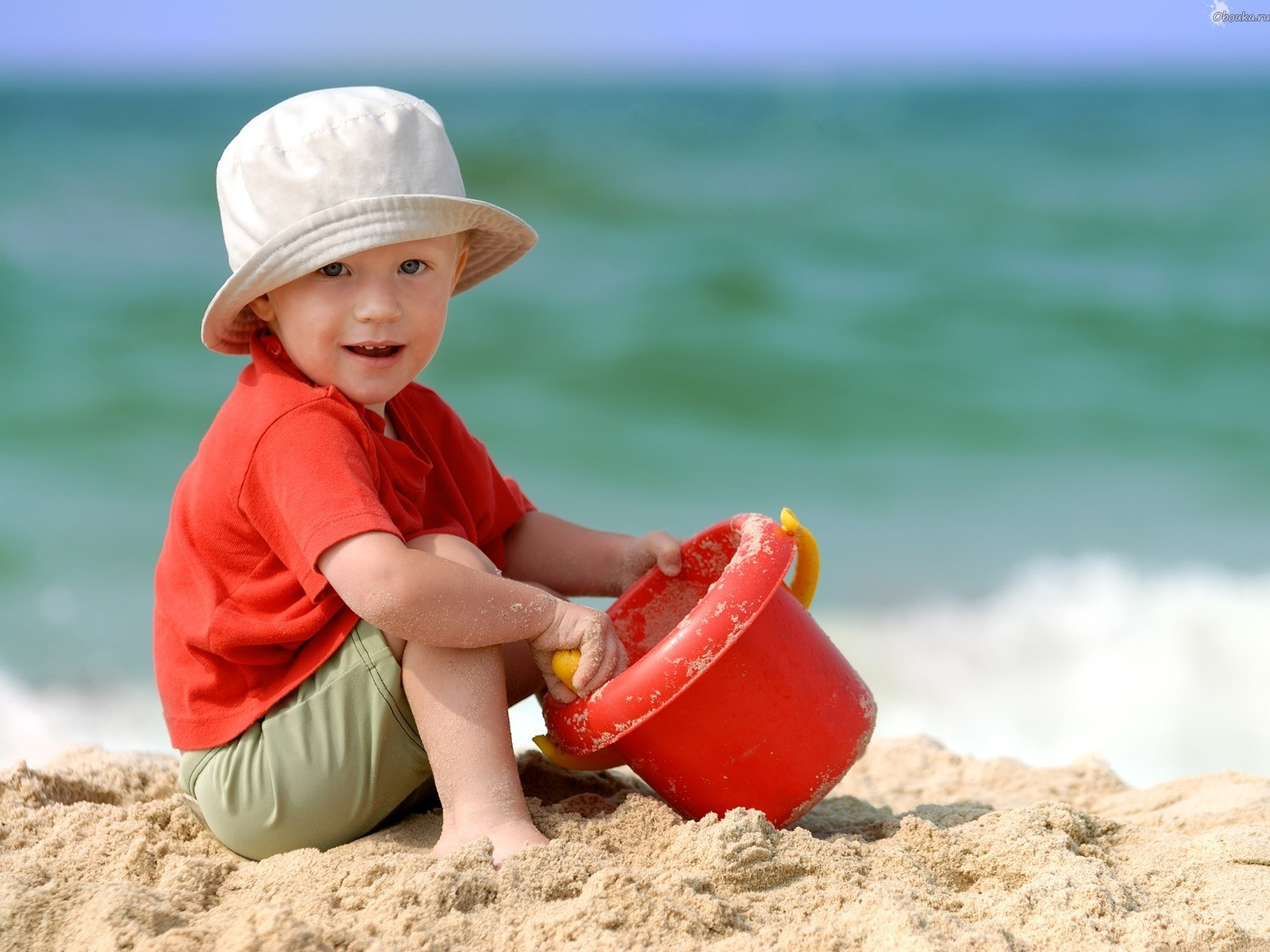 Baby boy playing on beach sand 1600 x 1200 download close
