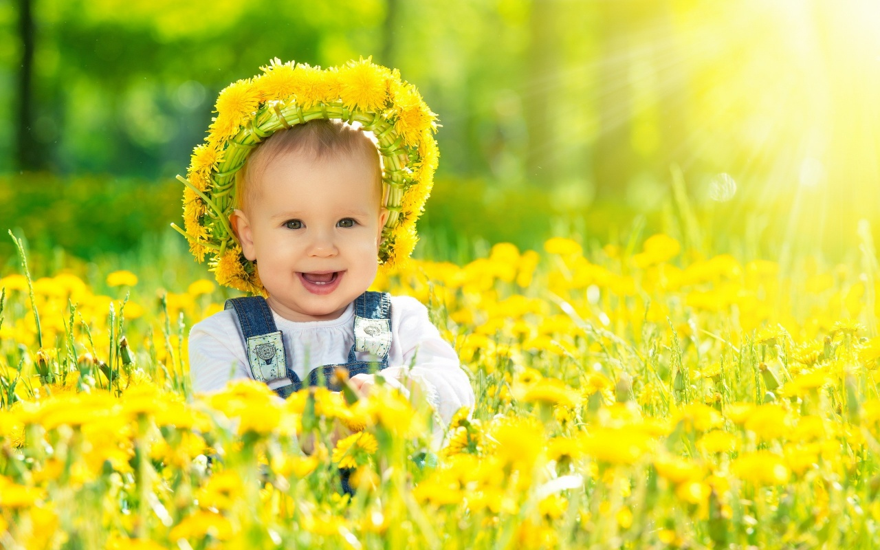Happy Baby Girl With Yellow Flowers Wallpapers
