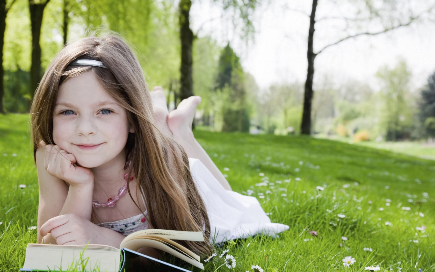 Little girl reading a book 1680 x 1050 download close