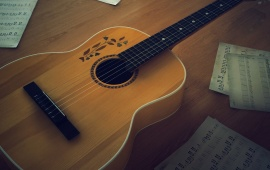 Acoustic Guitar With Music Note