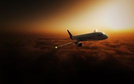 Airliner In Sunset Sky