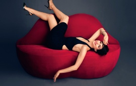 Anne Hathaway Laying On Sofa
