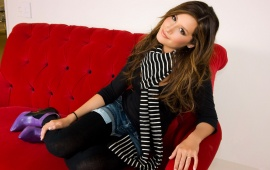 Ashley Tisdale in red couch