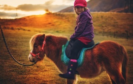 Baby Girl On Small Horse