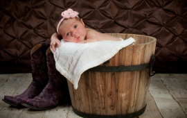 Baby With Blanket Barrel