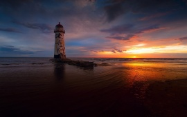 Beach Lighthouse At Sunset