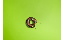 Bitten Donuts On Green Background