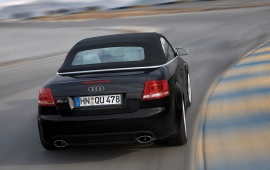 Black Audi RS4 rear on road