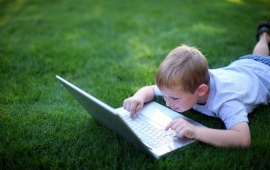 Boy With Laptop In Glade