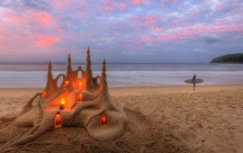Candles In Sand Castle
