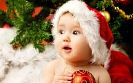 Christmas Baby Holding Red Ball