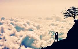 Cloudy Sky With Kissing Couple