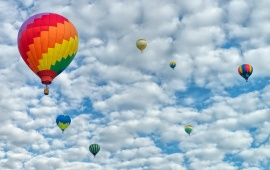 Colored Balloons On Cloudy Sky