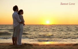 Couple On A Sunset Beach