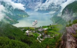 Cruise Ship On Mountain Lake