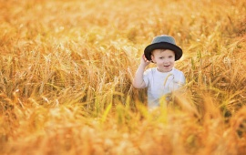 Cute Baby In Summer Field