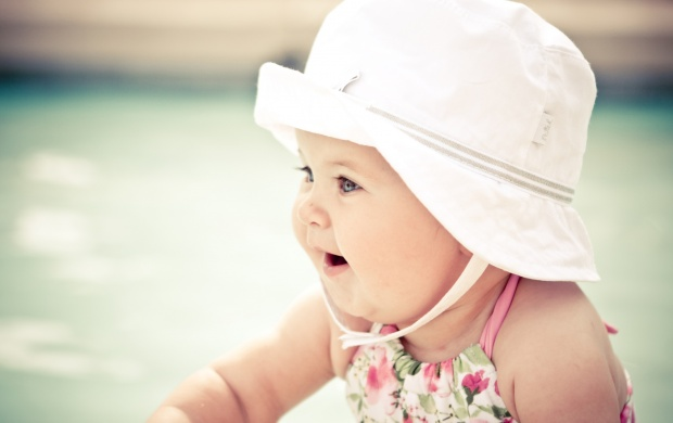 Cute Baby With White Hat (click to view)