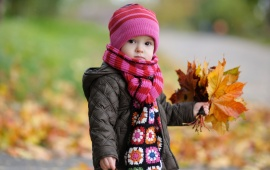 Cute Child With Autumn Leaves