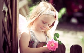 Cute Girl Holding Pink Rose