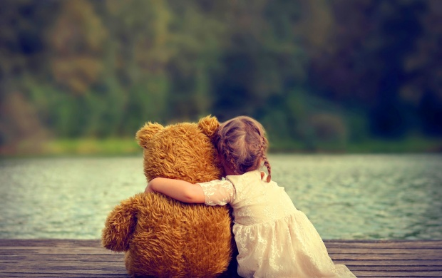 Cute Girl Hugging Teddy Bear (click to view)