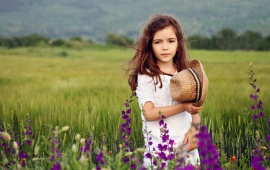 Cute Girl In Flowers Field