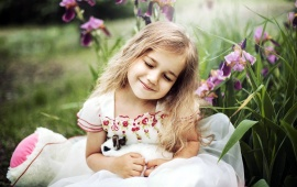 Cute Girl With Animals Irises Flowers