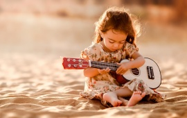 Cute Guitarist On Sand