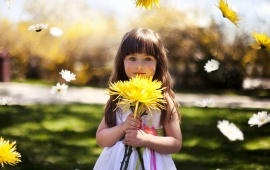 Cute Little Girl Holding Yellow Flower