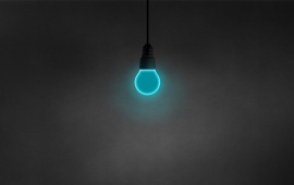 Cyan Light Bulb on Black Wall