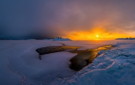 Dramatic Sunset Over Frozen Lake