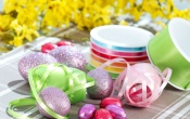 Easter Eggs And Ribbon On Table