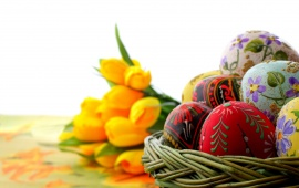Easter Eggs And Yellow Tulip Flowers