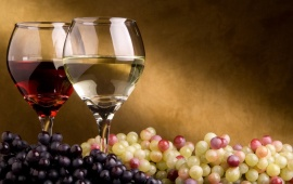 Elegant Wine Glass And Grapes