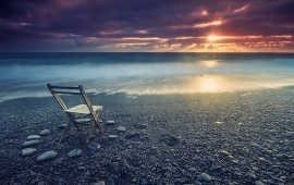 Empty Chair On A Beach