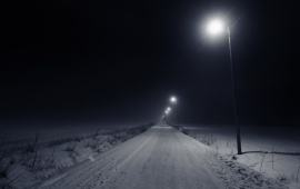 Empty Snowy Road At Night