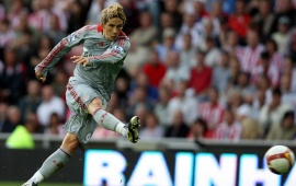 Fernando Torres kicking a Ball