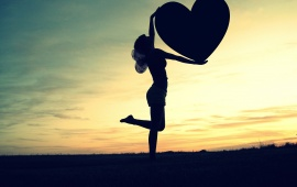 Girl Holding A Big Heart