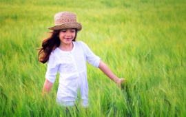 Girl In White Dress Plays In A Field