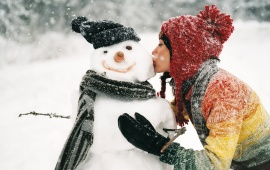Girl Kissing Snowman