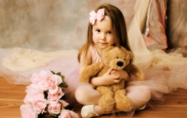 Girl Playing Brown Bear Toy