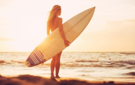 Girl Surfboard At Sunset Beach