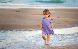 Girl With Purple Dress In The Sea