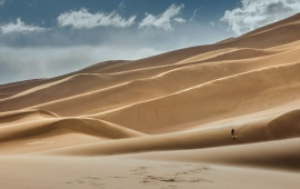 Guy Running On Sand Dunes