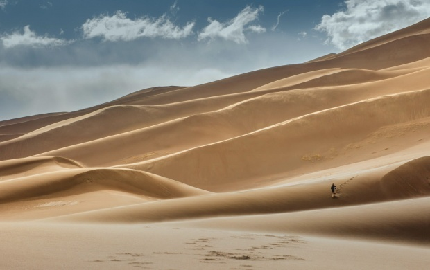 Guy Running On Sand Dunes (click to view)