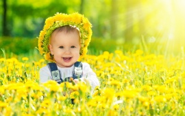 Happy Baby Girl With Yellow Flowers
