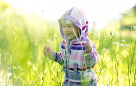 Happy Child And Grass