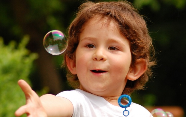 Happy Child Touching Bubble (click to view)