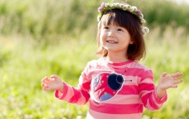 Happy Little Girl In Flowers Wreath