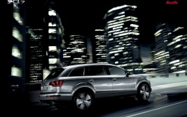 In Front Building Audi Q7 in city