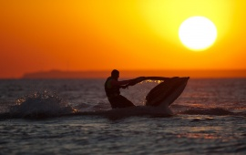 Jet Skis In The Sea At Sunset